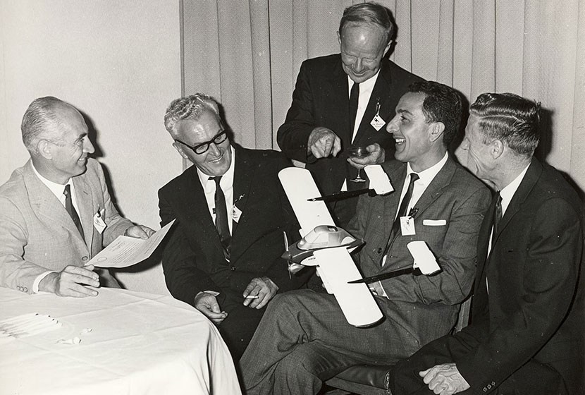 Early 1960s. Franco, Carlo and designer Luigi Pellarini examine a model of the Airtruk.