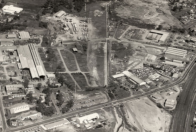 1970. Aerial view of Seven Hills factory complex. In the middle is Transavia's airstrip.