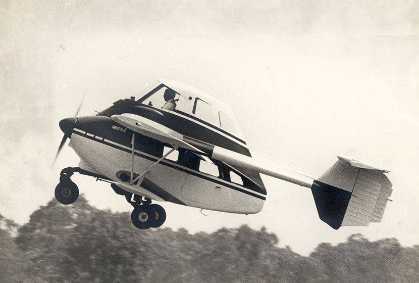 1960s. Airtruk in flight over Seven Hills.