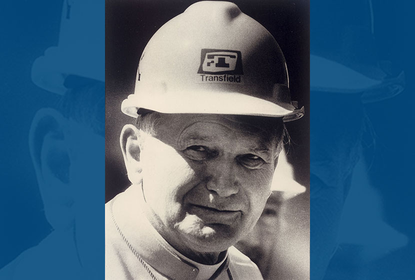 The famous photo of John Paul II wearing Transfield's safety helmet.