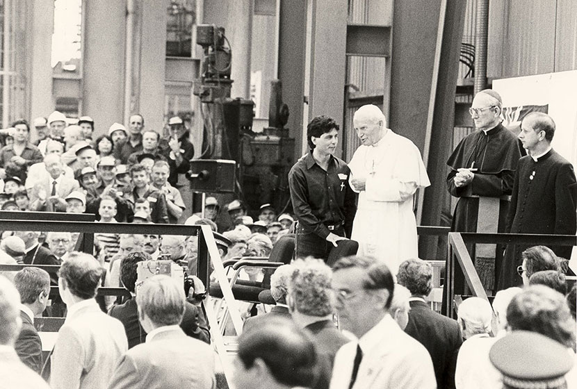 Seven Hills, November 1986. The Pope addresses the crowd assembled in one of Transfield's buildings.