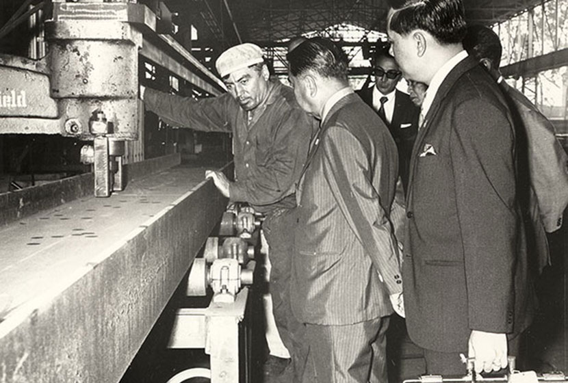 April 1972. Explaining how to drill a steel beam to a Thai delegation.