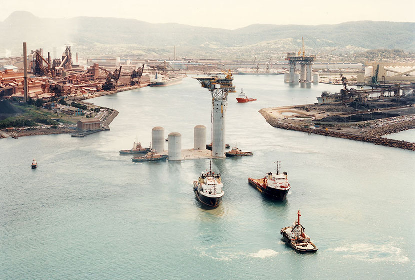 1996. The smaller oil rig being towed out of Port Kembla port.