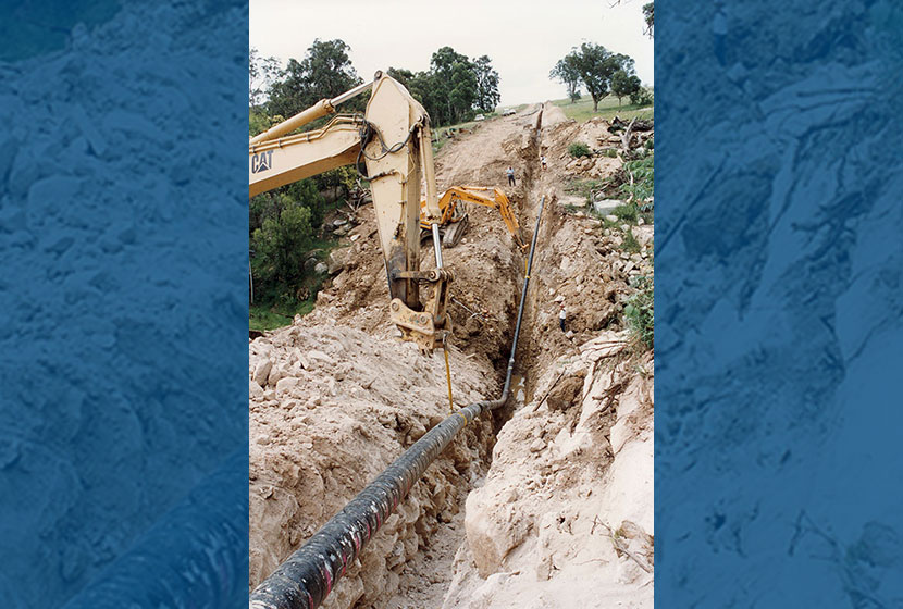 1996. Lying down a pipe on the Moomba-Sydney Natural Gas Line.