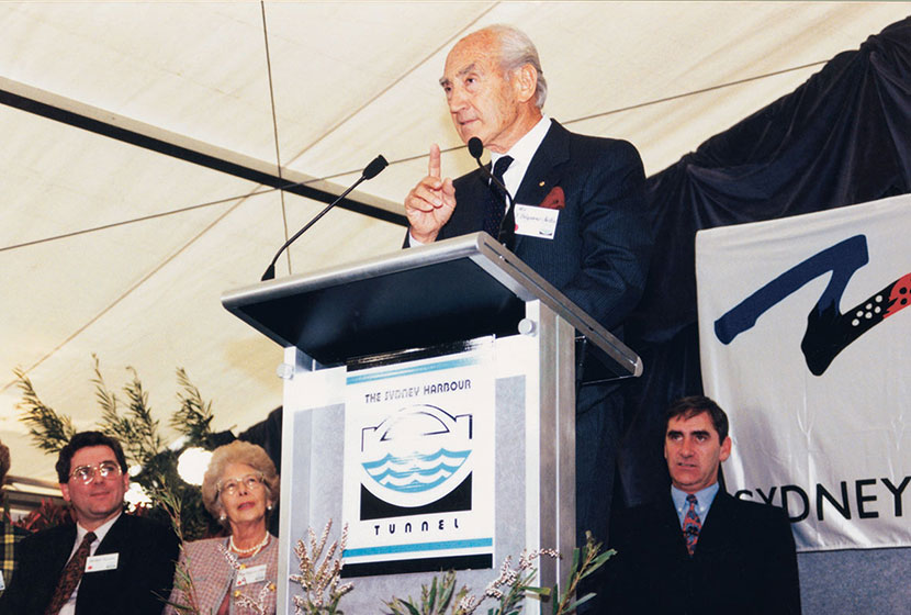 1992. Franco addresses the guests at the official opening of the Sydney Harbour Tunnel.