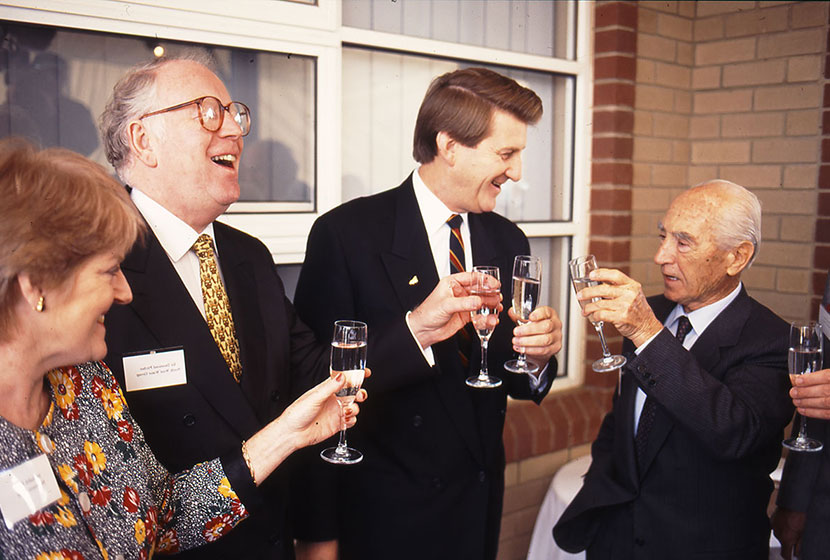 "29 May 1996. Franco enjoys a glass of champagne with Premier Jeff Kennett after the ""breaking the ground""."